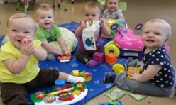 Babies Playing Together With Toys