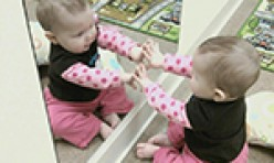 Baby Looking at Itself in a Mirror