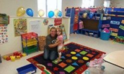 Teacher and Student Hugging In Play Area