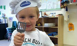 Young Boy Wearing a Chef's Cap and Spatula